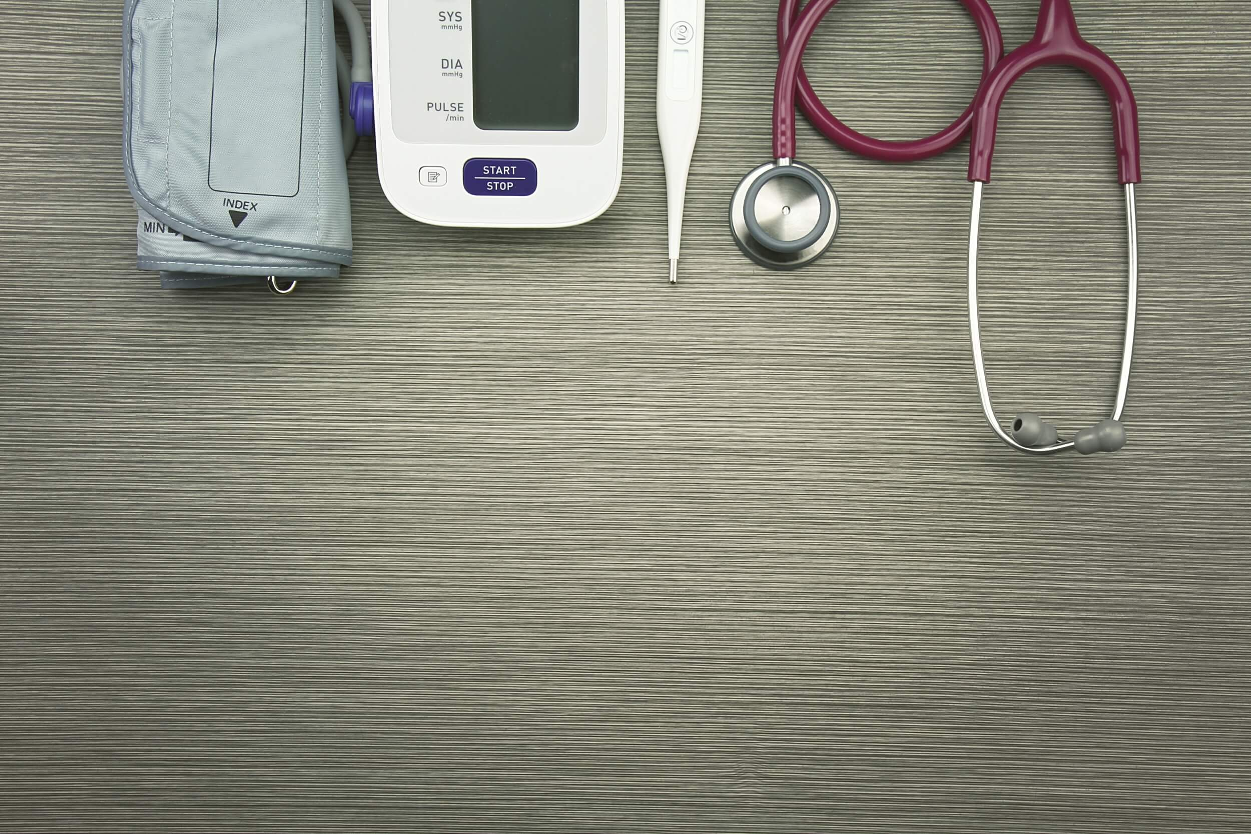 Medical instruments on a table - Heart Pressure Monitor and more