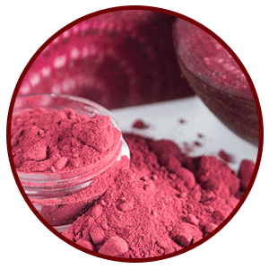 Glass ramekin with vibrant red BeetRoot Powder on a clean white counter