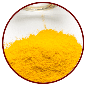 yellow powder COQ10 mounded up in a pile on a clean surface