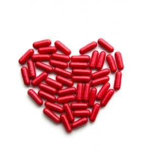 Red long pills in a heart form