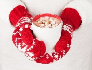 Female hands holding hot chocolate