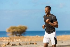 Black african american young man running outdoor