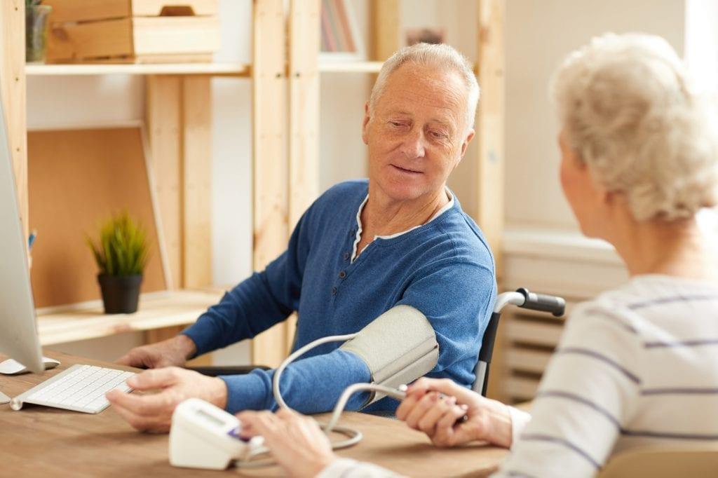 Elderly Couple Checking Blood Pressure