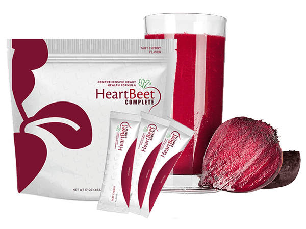 HeartBeet Complete® in a glass, sitting next to a beet and a pack of HeartBeet Complete®
